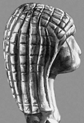 Голова женщины. Кость мамонта (из Брассанпуи, департамент Ланды, Франция). Верхний палеолит. Музей национальных древностей. Сен-Жермен-ан-Ле.