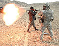 Afghan National Police officer fires an RPG round at a special mission conducted by US Army.jpg