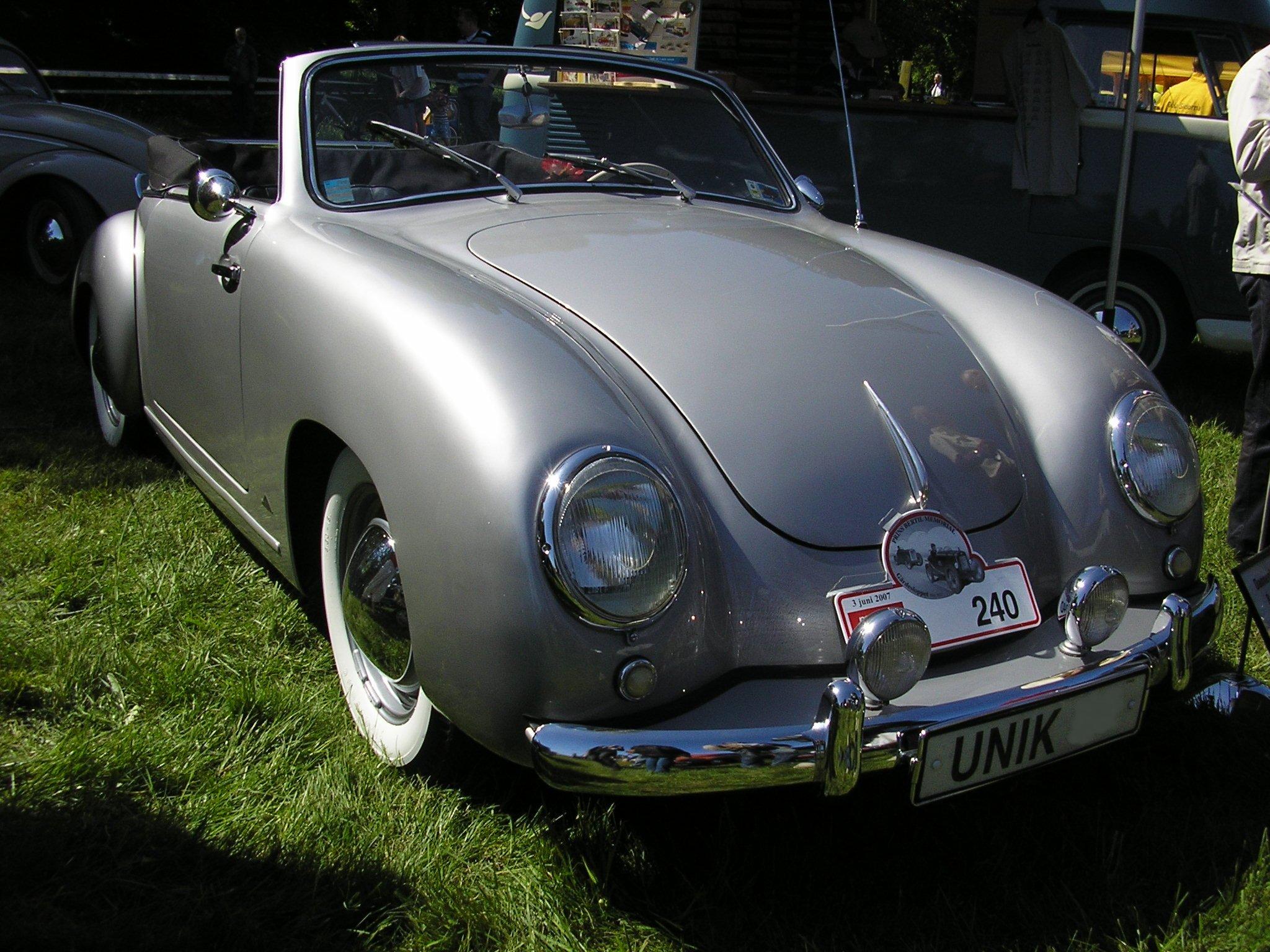 Porsche  история автомобильного бренда  tezCARru